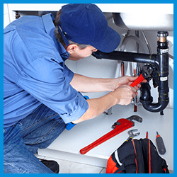 Plumbing service repairs tech